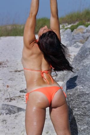 A beautiful woman wearing a bikini at the beach. photo