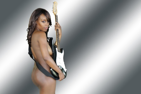 A beautiful naked woman with her electric guitar against a computer-generated background photo