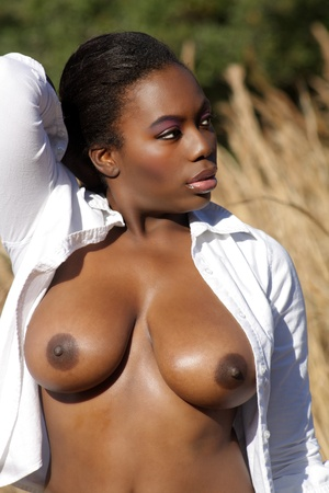 A close-up of a lovely, sexy black woman outdoors