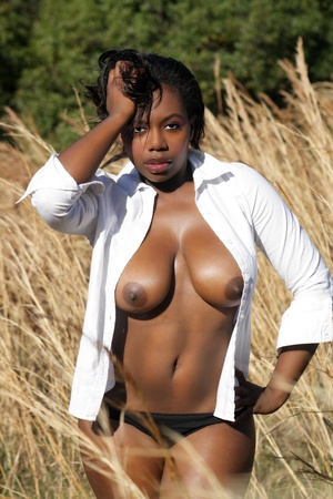 A lovely, sexy black woman outdoors