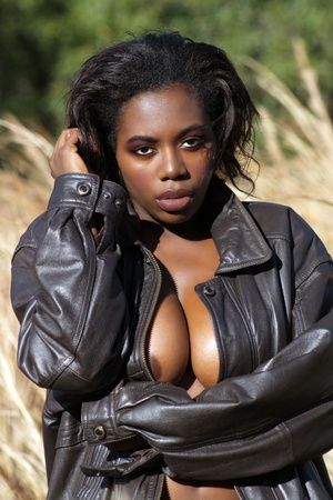 A close-up of a lovely, sexy black woman outdoors  Stock Photo - 12670425