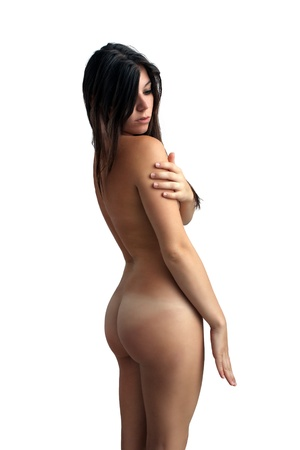nude woman standing: A lovely young brunette stands nude, isolated on a white background with generous copyspace.