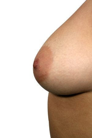 A close-up of a left female breast, unretouched, with generous copyspace.