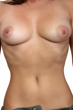 nude woman standing: A female torso with asymetric female breasts, unretouched  Stock Photo
