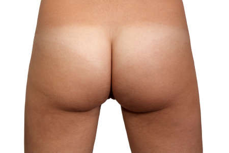 A close-up rear view of nude female buttocks, post-surgical after body contouring and shaping Stock Photo - 13774016