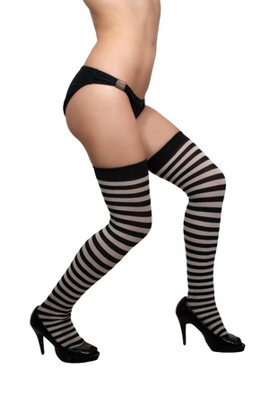 A female torso, legs, and feet with striped stockings  Stock Photo - 13773904