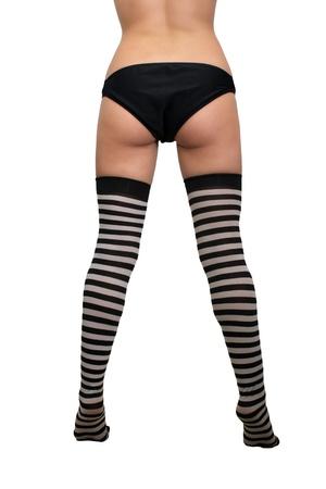 Ein weiblicher Torso, Beine und Füße mit gestreiften Strümpfen Standard-Bild - 13773903