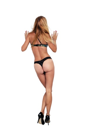 A beautiful, sexy blonde wearing black lace thong panties and a bra   Isolated on a white background with generous copyspace  photo