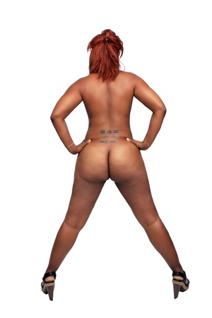 A full-length shot of a lovely young nude black woman with red hair, isolated on a white background with generous copyspace
