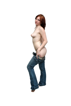 A lovely young topless redhead begins to remove her jeans   Isolated on a white background with generous copyspace  Stock Photo