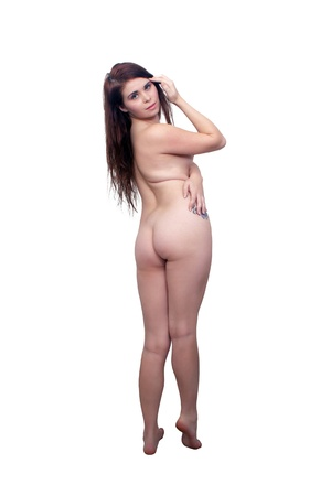 A lovely young, nude brunette standing, full-length, isolated on a white background with generous copyspace