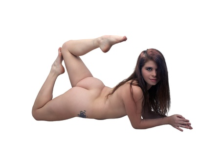 A lovely young, nude brunette lying, full-length, isolated on a white background with generous copyspace