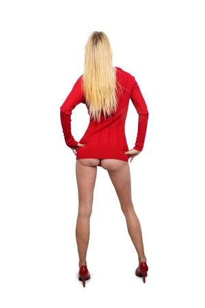 A full-length shot of a lovely blonde wearing a red sweater and giving a view of her marvelous ass   Isolated on a white background with generous copyspace