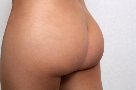 A close-up of lovely young female buttocks  Stock Photo - 17330134