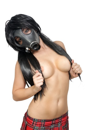 A sexy topless girl wearing a plaid micro-mini skirt and a gas mask   Isolated on a white background with generous copyspace  photo