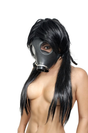 A sexy young topless girl wearing a gas mask   Isolated on a white background with generous copyspace