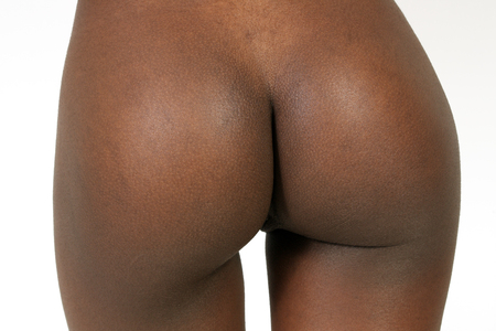 A close-up of the perfect bare buttocks of a young petite woman.
