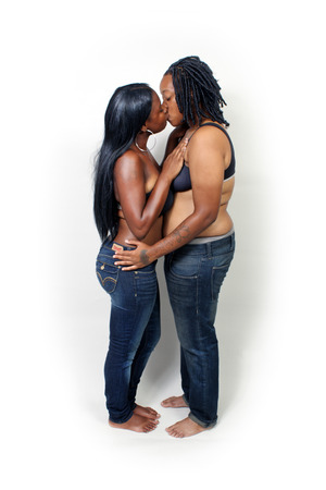 A black lesbian couple, isolated on a white background with generous copyspace. photo