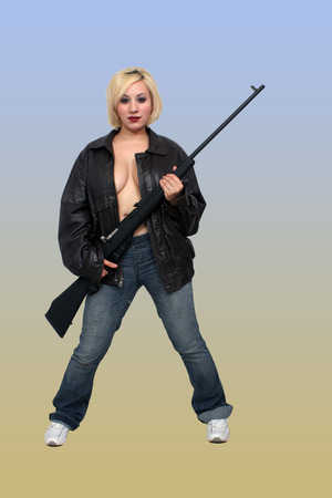 A lovely, busty blonde holds a reworked Russian military rifle.  Isolated on a gradient gold and blue background with generous copyspace.