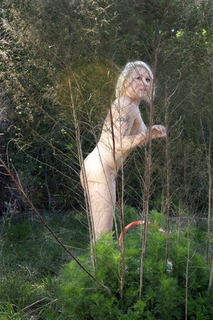 A lovely blonde enjoys nature in her natural state.