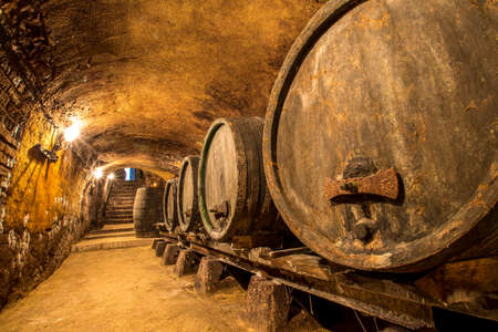 Old wine cellar with traditional casks 写真素材