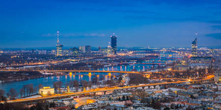Vienna skyline with river danube at sunset