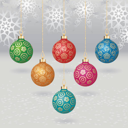 christmas balls with gold design on light background with flakes