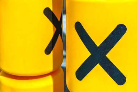 Rotating plastic yellow cylinders with a play of tic-tac-toe for children entertainment Stok Fotoğraf