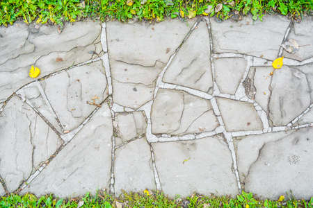 City street stone pavement. Top view on cobblestoned pavement background. Abstract background of old cobblestone pavement street