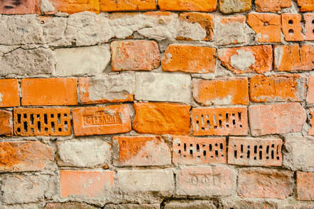 Empty Old Brick Wall Texture. Grungy Brickwall Surface. Grunge Red Stonewall Background. Shabby Building Facade Wall With Damaged Plaster and Distressed Orange Bricks