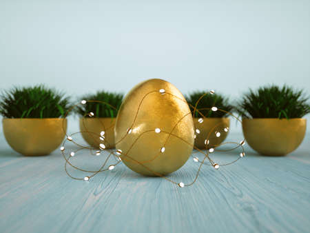 Golden egg, hank of romantic luminous garland with white light bulbs and golden flower bowls with grass on the light blue rustic wooden table. Shabby-chic style background for the holidays Stockfoto