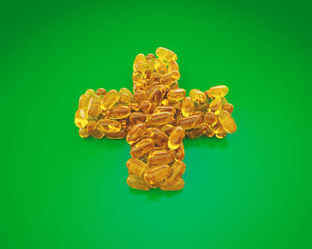 Fish Oil Capsules for health are in the shape of a medical cross. Omega-3 and vitamin capsules isolated on green background. Healthy lifestyle concept. 3D Illustration