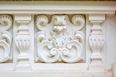 Vintage architectural stucco molding decorations of buildings wall texture. Old antique plaster molding and patterns. Wall border ornament with column as architecture building detail facade decor 스톡 콘텐츠