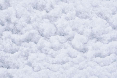 Winter texture of white fluffy snow covered surface. White fresh snow background