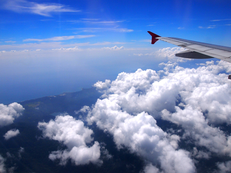 Airplane wing view from window with beautiful sky photo