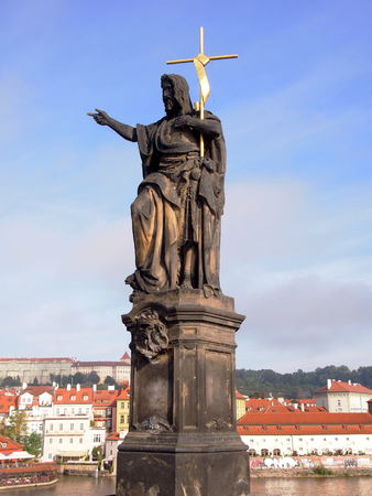 st charles: Statue of St. John the Baptist the sculpture of Charles Bridge in Prague Czech Republic Stock Photo