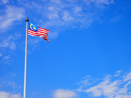 Malaysia flag waving on the wind with blue sky