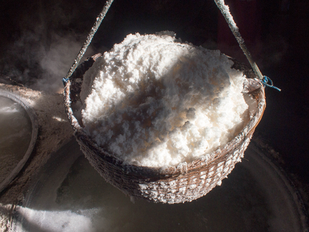 Boiling rock salt, crystallized salt from boiled saltwater to dried up the basket, travel landmark in Thailand. Фото со стока