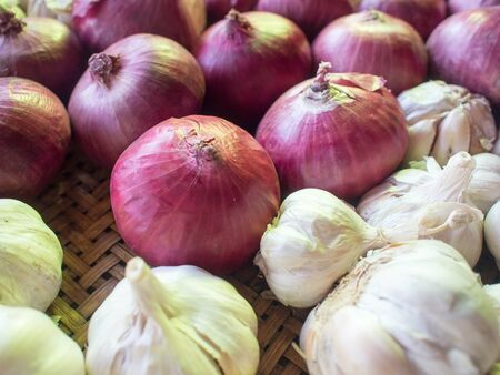 Onions and garlic in basket.