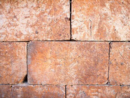 Old bricks stone wall, rock brick wall. Standard-Bild