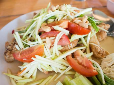 Papaya Salad (Som Tum Thai) on table, popular Thai food. Standard-Bild