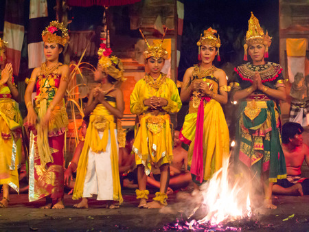 BALI, INDONESIA - MAY 14: Presentation of traditional balinese Fire Dance on MAY 14, 2013 on Bali. Kecak is very popular cultural show on Bali, Indonesia. Editorial
