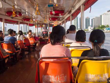 BANGKOK, THAILAND - JANUARY 29 : Thai people passengers and foreigner travelers sit on boat at Chao Phraya river at Bangkok in January, 2017 at Bangkok, Thailand Editorial