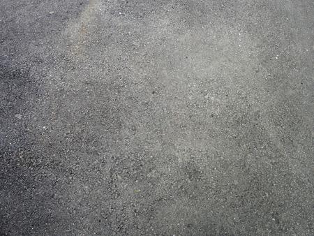 Dark grey texture of the floor.