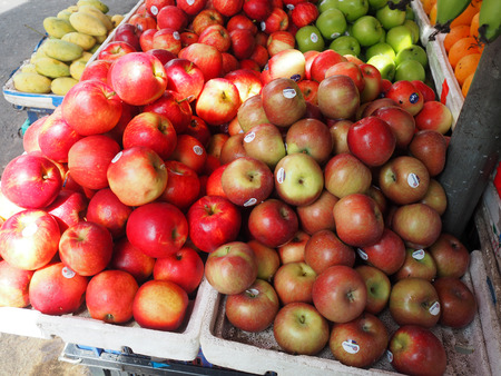 Apples and other fruits display on the market stand.