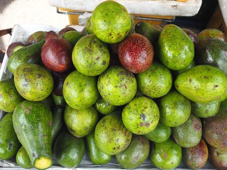 Local avocados in Russian market, Phnom Penh Cambodia. Standard-Bild