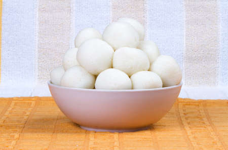 Rasgulla is a syrupy dessert popular in the Indian Festivals and It is made from ball shaped dumplings of chhena and semolina dough, cooked in light syrup made of sugar and cow milk Stock Photo