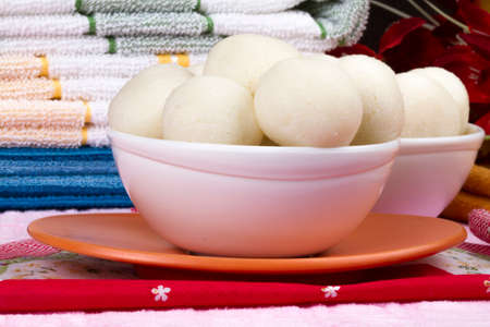 Rasgulla is a syrupy dessert popular in the Indian Festivals and It is made from ball shaped dumplings of chhena and semolina dough, cooked in light syrup made of sugar and cow milk Imagens