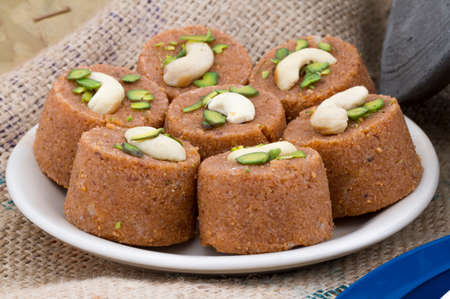 Pinni is a type of Punjabi and North Indian cuisine dish that is eaten mostly in winters. It is served as a dessert and is made from desi ghee, wheat flour, jaggery and almonds