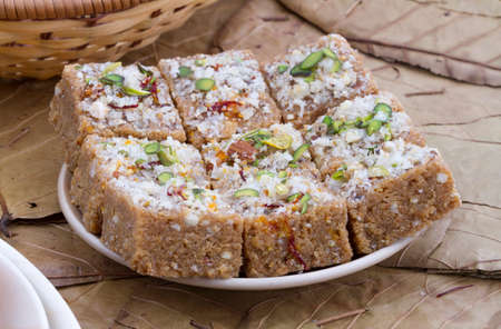 Gond pak is one of the dessert recipes that is usually served as a sweet. It is mainly made in wintery days in Gujarati houses Imagens
